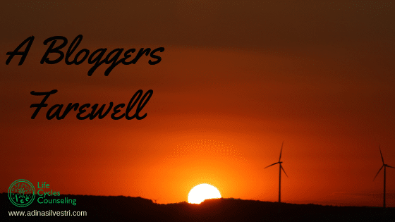 image of a sunset with windmills in the background